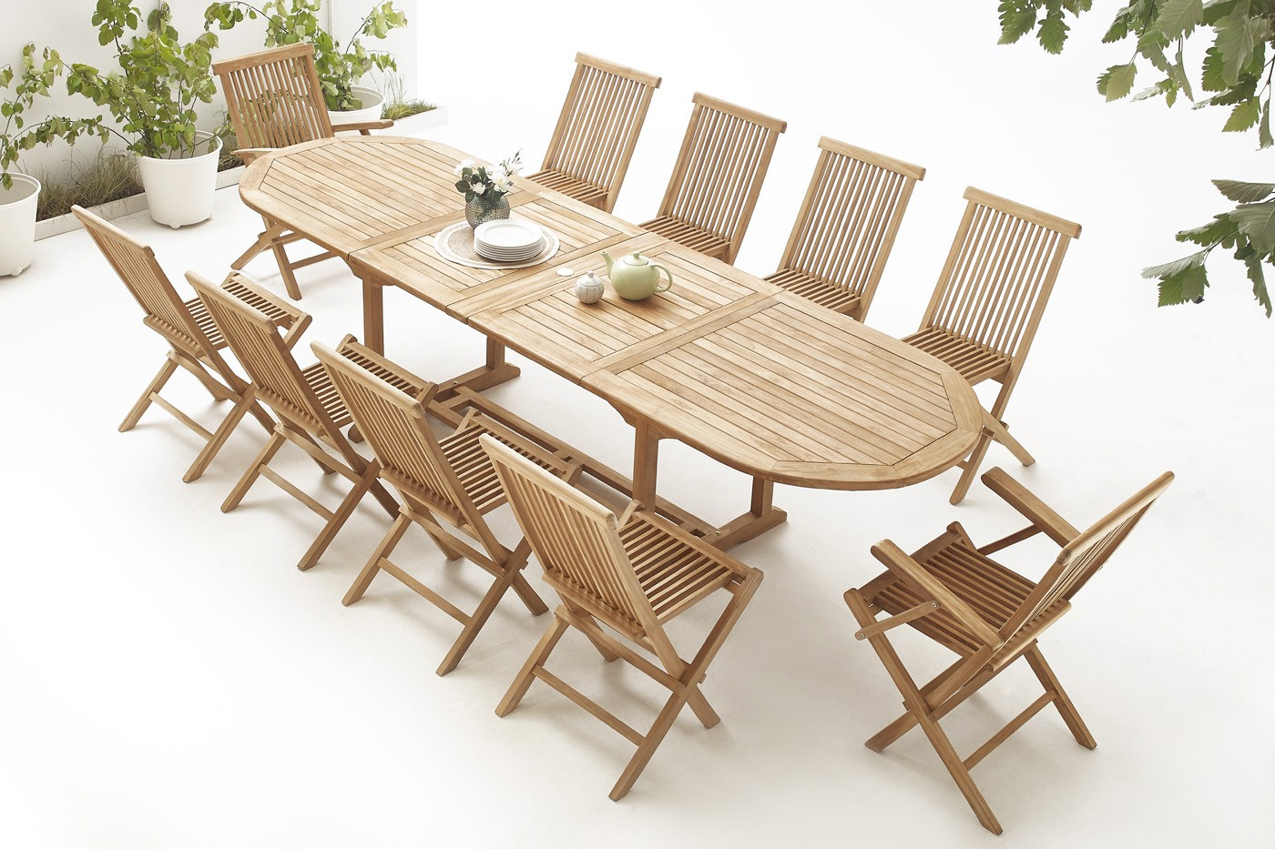 Table ovale 8 chaises 2 fauteuils teck brut massif for Table exterieur teck massif